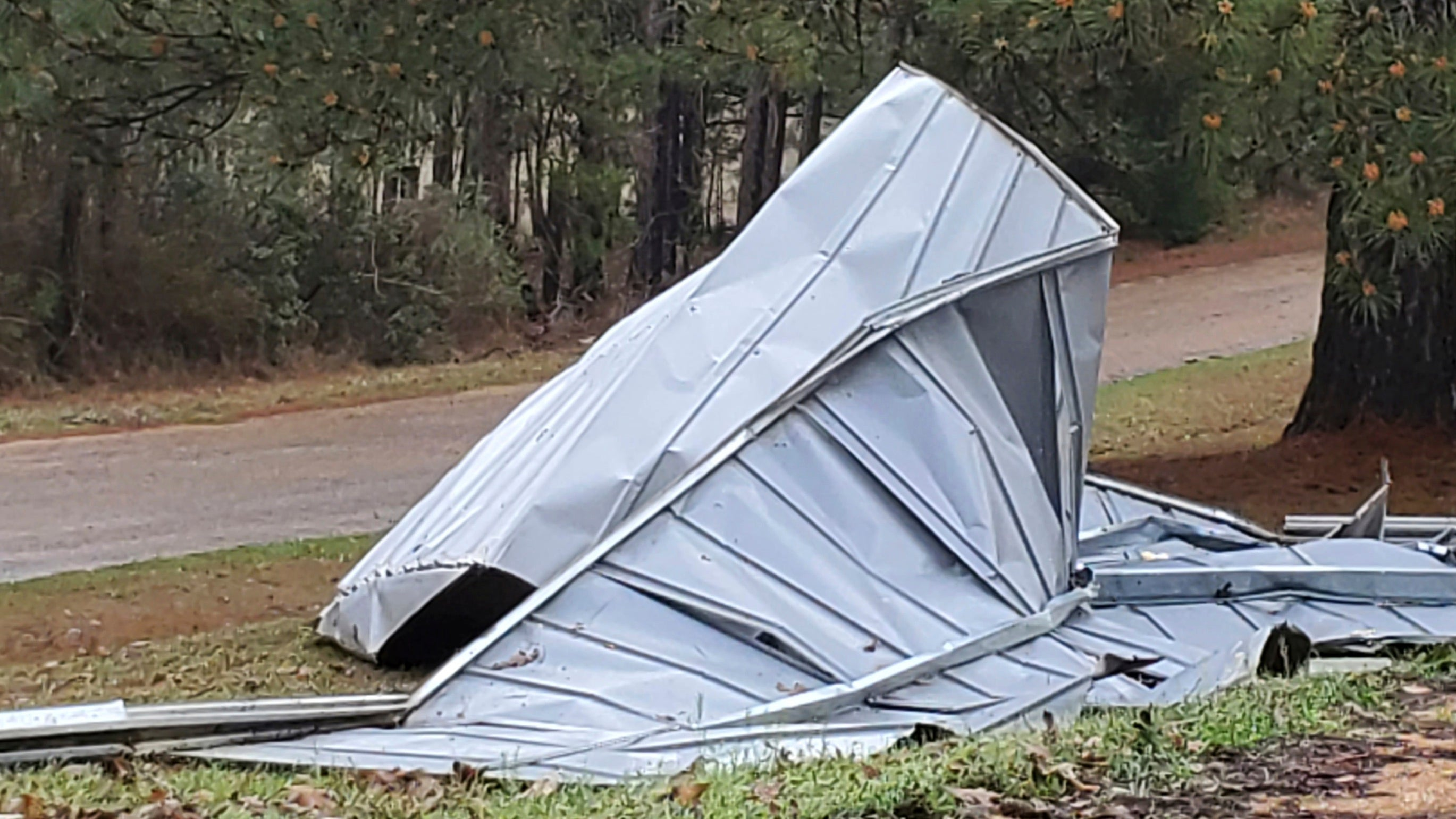 This tin roof was blown off a building by severe winds in the Woolworth community in northeast Lincoln County, Miss., Wednesday, March 17, 2021. Forecasters believe more severe weather is expected Wednesday with the potential for massive tornadoes, downpours and hail the size of tennis balls. (Brett Campbell/The Daily Leader)