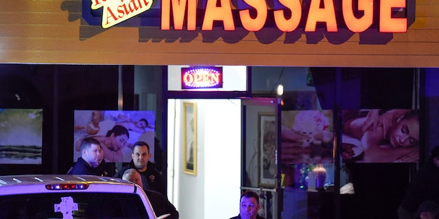 Authorities investigate a fatal shooting at a massage parlor, late Tuesday, March 16, 2021, in Acworth, Ga. Officials say 21-year-old Robert Aaron Long, of Woodstock, Georgia, has been captured hours after multiple people were killed in shootings at three Atlanta-area massage parlors. (AP Photo/Mike Stewart)